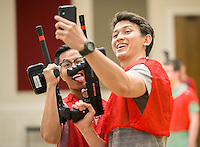 NWA Democrat-Gazette/JASON IVESTER <br /> University of Arkansas senior Hung Duong (cq) (left) and junior Dom Goy (cq) take a selfie on Thursday, Sept. 24, 2015, before playing laser tag inside the Arkansas Union on the Fayetteville campus. The free event for students was hosted by University Programs Daytime Committe.
