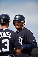Detroit Tigers right fielder Tyler Collins (18) talks with first base coach Omar Vizquel (13) during an exhibition game against the Florida Southern Moccasins on February 29, 2016 at Joker Marchant Stadium in Lakeland, Florida.  Detroit defeated Florida Southern 7-2.  (Mike Janes/Four Seam Images)