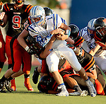 SIOUX FALLS, SD - SEPTEMBER 19: Austin Hagen #1 from Rapid City Stevens is brought down by a host of defenders from Washington in the second quarter of their game Friday night at Howard Wood Field.  (Photo by Dave Eggen/Inertia)