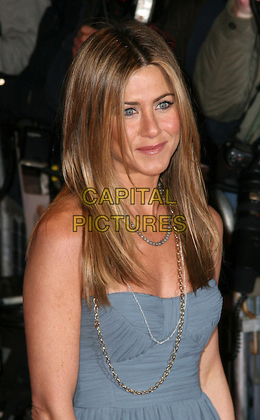 """JENNIFER ANISTON.""""Marley & Me"""" UK film premiere held at .Vue cinema, Leicester Square, London, England,  2nd March 2009..And  half length Burberry blue strapless  straight grey gray necklaces beads gold chain .CAP/JIL.©Jill Mayhew/Capital Pictures"""