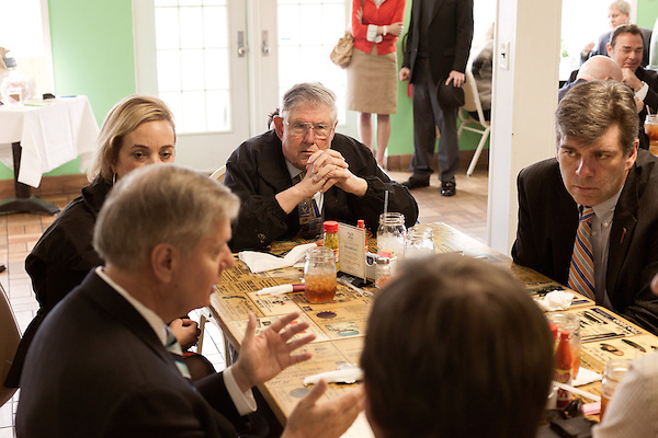 March 26, 2013. West Columbia, South Carolina . Sam Kopack, top center, listens to Sen. Lindsey Graham talk to diners at Mrs. B's Southern Kitchen about his plans for the political season.. Sen. Lindsey Graham, R- South Carolina, is up for reelection in 2014. He spent some time talking to his base back home about issues such as immigration reform as he readies himself for his campaign run..