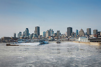 Montreal skyline, seen from across the frozen river in winter, in Quebec, Canada. Picture by Manuel Cohen