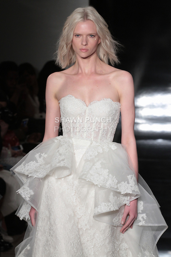 Model walks runway in a re-embroidered strapless lace corset gown with detachable organza overskirt, from the Reem Acra Spring 2017 bridal collection, during New York Bridal Fashion Week Spring Summer 2017, on April 15, 2016.