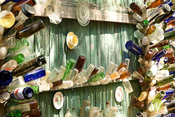 Bottles on spindles.