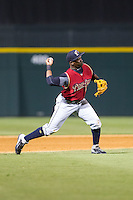 Scranton/Wilkes-Barre RailRiders third baseman Adonis Garcia (10) makes a throw to first base against the Charlotte Knights at BB&T Ballpark on July 17, 2014 in Charlotte, North Carolina.  The Knights defeated the RailRiders 9-5.  (Brian Westerholt/Four Seam Images)