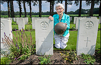 BNPS.co.uk (01202 558833)<br /> Pic: PhilYeomans/BNPS<br /> <br /> Willemein Rieken with the recently rediscovered helmet worn by Trooper Edmunds at his grave at Arnhem.<br /> <br /> Arnhem flowergirl finally honoured - Willemien was suprised to be presented with flowers and a certificate by Parachute Regiment veterans at the weekend.<br /> <br /> A Dutch woman who has tended to the grave of a British paratrooper killed at the Battle of Arnhem for 75 years has been presented with flowers from his regiment as a token of their gratitude.<br /> <br /> Every year Willemien Rieken, 84, lays flowers at Oosterbeek War Cemetery in memory of Trooper William Edmond who was shot by a German sniper after landing in Holland in World War Two.<br /> <br /> She was surprised at his grave by a member of Tpr Edmond's 1st Airborne Reconnaissance Squadron at a ceremony marking the 75th anniversary of the battle.