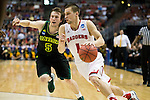 Wisconsin Badgers guard Ben Brust (1) drives to the basket during the fourth-round game in the NCAA college basketball tournament against the Baylor Bears Thursday, March 27, 2014 in Anaheim, California. The Badgers won 69-52. (Photo by David Stluka)