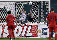 WASHINGTON, DC - July 28, 2012:  Chris Pontius (13) of DC United watches Nicolas Douchez (1) of PSG (Paris Saint-Germain) make a save in an international friendly match at RFK Stadium in Washington DC on July 28. The game ended in a 1-1 tie.