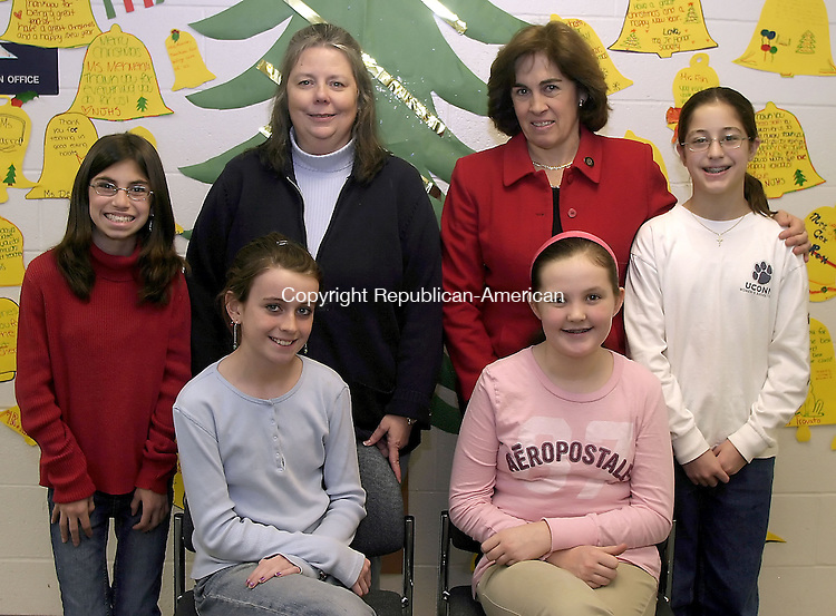 WOLCOTT, CT -15 December 2006 - 121506DA02. Friday morning students at Tyrrell Middle School in Wolcott, pose for a photo, standing right, Sarah Keane. advisor to writing club, Mrs.Cordone, principal, Mrs. Tansley, and Danielle Fournier, siting, Tara Collins, and Caroline Sexton. The 7th graders took part in an after school club program, Holiday Memory series, writing to get into the holiday spirit and remembering good times with family.  Darlene Douty/Republican-American