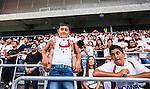 Stockholm 2014-07-28 Fotboll Superettan Hammarby IF - Assyriska FF :  <br /> Ung Assyriskasupporter med en tshirt med ett tecken p&aring;<br /> (Foto: Kenta J&ouml;nsson) Nyckelord:  Superettan Tele2 Arena Hammarby HIF Bajen Assyriska AFF supporter fans publik supporters
