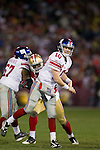 New York Giants quarterback Eli Manning (10) throws a touchdown pass during an NFC Championship NFL football game against the San Francisco 49ers on January 22, 2012 in San Francisco, California. The Giants won 20-17 in overtime. (AP Photo/David Stluka)