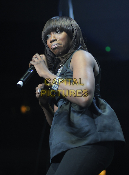 ESTELLE .live at The102.7's KIIS-FM's Jingle Ball 08 held at The Honda Center in Anaheim, California, USA, .December 6th 2008                                                                     .music gig on stage half length fringe black top necklace microphone funny face mouth .CAP/DVS.©Debbie VanStory/Capital Pictures