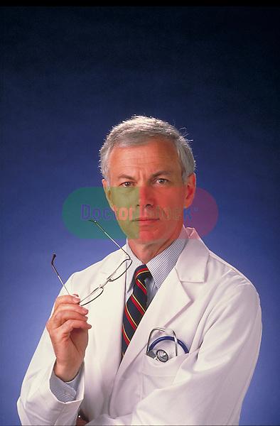 portrait of male doctor holding eyeglasses