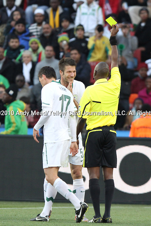 18 JUN 2010: Referee Koman Coulibaly (MLI) (right) shows a yellow card to Bostjan Cesar (SVN) (5). The Slovenia National Team tied the United States National Team 2-2 at Ellis Park Stadium in Johannesburg, South Africa in a 2010 FIFA World Cup Group C match.