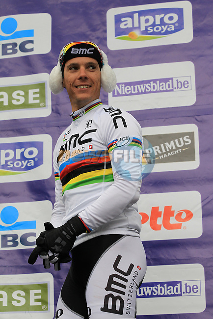 World Champion Philippe Gilbert (BEL) BMC Racing Team rider on the podium with temperatures at -3 and wind chill of -16 at the sign on before the 75th edition of Gent-Wevelgem in Deinze, Belgium, 24th  March 2013 (Photo by Eoin Clarke 2013)