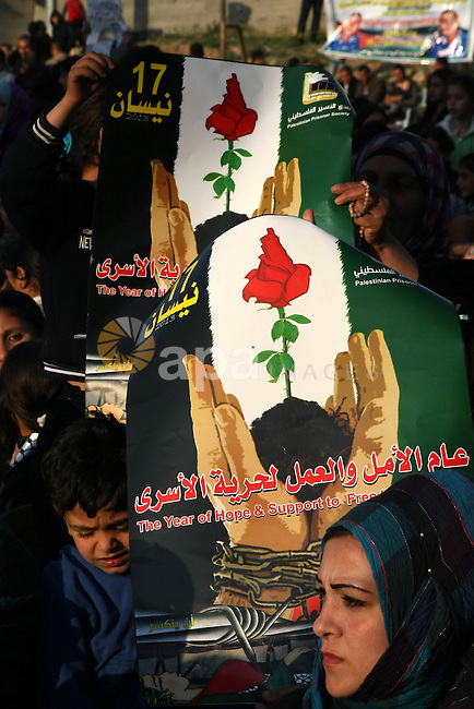 Palestinian women and children carry their national flags during a rally on the eve of Prisoners' Day, in village of Saair near the West Bank city of Hebron, on 16, 2013. The Palestinian Prisoner Club said in a report that as of 2013 there were close to 5,000 Palestinian prisoner spread over 27 prisons, jails, detention centers and interrogation centers. Photo by Mamoun Wazwaz