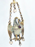 BNPS.co.uk (01202 558833)<br /> Pic: KidsonTrigg/BNPS<br /> <br /> £30,000 - 16th Century 'pelican in her piety' pendant with green enamel decoration, cabochon ruby & pearl trio of drops.<br /> <br /> Frozen Assets - Over a £100,000 of Renaissance era jewellry found under a frozen joint of lamb in a run down chalet bungalow is coming up for auction.<br /> <br /> Amazed auctioneers found the hidden gems in the ramshakle hoarders freezer near Uffington in Wiltshire - where the canny late owner had gone to great lengths to protect her precious haul.<br /> <br /> However, the hidden stash wasn't the result of a bank heist but belonged to an eccentric collector who amassed the items in the 1960s - and kept the receipts to prove it.<br /> <br /> She passed away recently and her family brought in experts to hunt out relics they knew their relative had hidden away over the years.