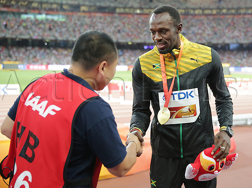 28.08.2015. Birds Nest Stadium, Beijing, China.  The TV cameraman (L), who drove into Jamaica's Usain Bolt (R) with a segway after the 200m final, apologizes to Bolt after the medal ceremony of the men's 200m final during the Beijing 2015 IAAF World Championships at the National Stadium, also known as Bird's Nest, in Beijing, China, 28 August 2015. Bolt won the gold medal in the 200m race.