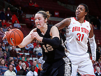 Army Black Knights forward Olivia Schretzman (12) and Ohio State Buckeyes guard Raven Ferguson (31) chase a rebound during Friday's NCAA Division I basketball game at Value City Arena in Columbus on December 13, 2013. Ohio State won the game 59-56. (Barbara J. Perenic/The Columbus Dispatch)