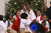 First Lady Melania Trump participates in arts and crafts projects with children and students from Joint Base Andrews in the East Room of the White House in Washington, DC, November 27, 2017.<br /> Credit: Olivier Douliery / Pool via CNP