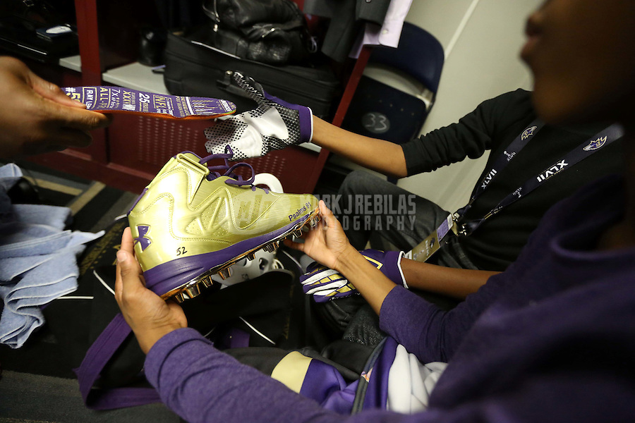 Feb 3, 2013; New Orleans, LA, USA; Baltimore Ravens inside linebacker Ray Lewis (not pictured) hands his custom shoes and soles to his children in the locker room after defeating the San Francisco 49ers in Super Bowl XLVII at the Mercedes-Benz Superdome. Mandatory Credit: Mark J. Rebilas-