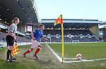 Assistant referee Lorraine Clark watches as Lewis MacLeod takes a corner kick at Ibrox