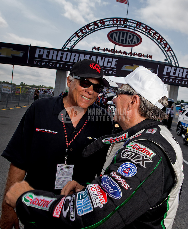 Sept. 1, 2013; Clermont, IN, USA: NHRA funny car driver John Force (right) with Don Prudhomme during qualifying for the US Nationals at Lucas Oil Raceway. Mandatory Credit: Mark J. Rebilas-