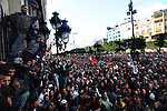 Demonstrators climb the walls of the Interior Ministry in downtown Tunis, Tunisia, Jan. 14, 2011. Several thousand people gathered outside the Ministry to protest and ask President Zine El Abidine Ben Ali to resign.