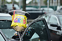 """PEMBROKE PINES, FL - MAY 15: A balloon that reads, """"Congrats Grad"""" hangs on a car in the parking lot at Pembroke Pines Charter High School on May 15, 2020 in Pembroke Pines, Florida. Because of social distancing mandates instituted by the state to curtail the spread of COVID-19, the 2020 graduates received their diplomas in a near-empty auditorium with no friends, family or relatives allowed to attend. A video of each student walking the stage to receive their diploma will be streamed on the school's scheduled graduation date of May 29.  ( Photo by Johnny Louis / jlnphotography.com )"""