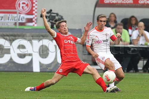 20.10.2012. Dusseldorf, Germany.  Dusseldorf versus  FC Bayern Munich. Andreas Lambertz Fortuna Duesseldorf Philipp Lahm FC Bayern Munich