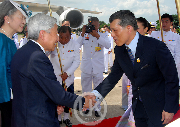 Emperor Akihito & Empress Michiko of Japan arrive at Don Muang Airport to attend the celebrations to mark the 60th anniversary of Thai King Bhumibol Adulyadej's accession to the throne. They were met by Crown Prince Maha Vajiralongkorn of Thailand...Pool Picture supplied by UK Press Ltd