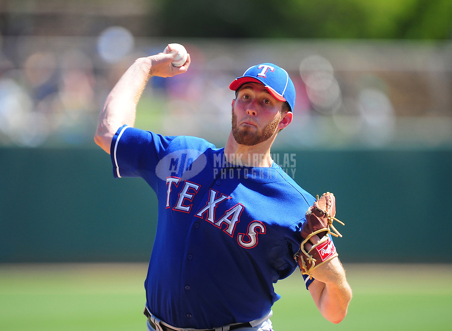 Mar. 16, 2012; Phoenix, AZ, USA; Texas Rangers pitcher Greg Reynolds throws in the first inning against the Los Angeles Dodgers at The Ballpark at Camelback Ranch. Mandatory Credit: Mark J. Rebilas-