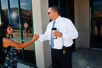 "Lindsay, California, September 5, 2012 - Lindsay High School Principal Jaime Robles shakes hands with students before class. Robles takes a vary hands-on approach to his job, as does the faculty. ""We are here to do what is best for the kids,"" says Robles, ""Not what is mist convenient for us.""..The school began building a competency-based education model about 7 years ago, fully implementing it just over three years ago and is set to graduate its first class this school year. This model does away with traditional grading and pass/fail for grades. Instead students are expected to achieve proficiency in a range of areas in each class, where a 3 (equal to a traditional B) is passing; A 4 is considered intensive and usually denotes college bound. Says Principal Jaime Robles, ?This allows students to learn at there own pace. If a student is advanced, they can move ahead, and if a student is lagging, they get the support they need.? Part of this model allows for students who are more advanced dig deeper and push harder and truly move ahead of others. Because they are ahead, some spend the extra time learning more, others take concurrent classes at the nearby community college and some choose to graduate early to start their path. ?Each student has their own set of goals,? says English teacher Amalia Lopez, ?Whatever their goals are, we support them.?.Slug: DD_ CompetencyByline: Daryl Peveto / LUCEO for Education Week"