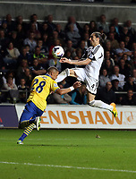 Saturday 28 September 2013<br /> Pictured: Chico Flores of Swansea (R) against Keiran Gibbs of Arsenal (L)<br /> Re: Barclay's Premier League, Swansea City FC v Arsenal at the Liberty Stadium, south Wales.