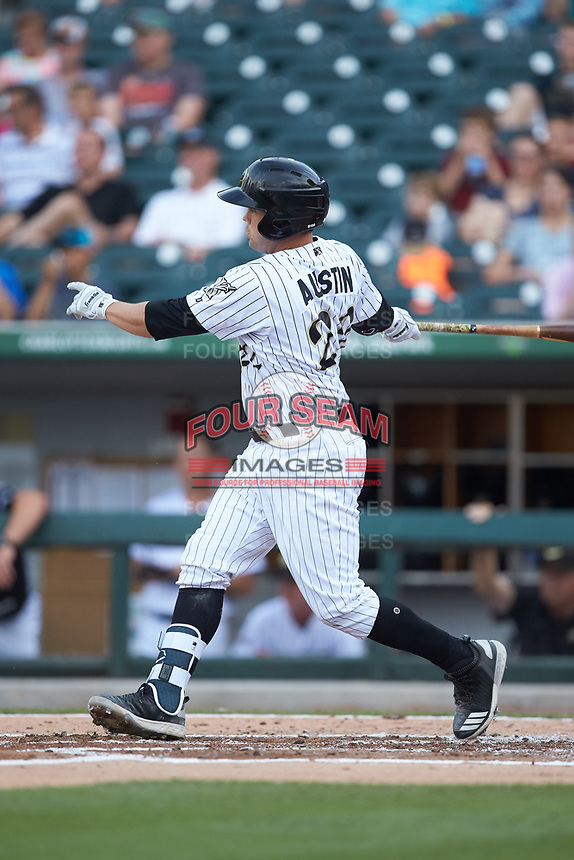 Brett Austin (22) of the Charlotte Knights follows through on his swing against the Indianapolis Indians at BB&T BallPark on May 26, 2018 in Charlotte, North Carolina. The Indians defeated the Knights 6-2.  (Brian Westerholt/Four Seam Images)