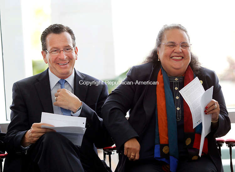 Waterbury, CT-08 June 2012-060812CM01-  Governor Dannel P. Malloy and Dr. Daisy Cocco De Filippis, President of the Naugatuck Valley Community College share a laugh during an announcement of the GEAR UP (Gaining Early Awareness and Readiness for Undergraduate Programs) Grant Awards at the Technology Hall Atrium inside the Naugatuck Valley Community College Friday afternoon in Waterbury.  The city of Waterbury is receiving a $11.2 million in GEAR UP funding from the State of Connecticut.  GEAR UP  is a federally-funded discretionary grant program designed to significantly increase the number of low-income students who are prepared to enter and succeed in college.  NVCC will serve as fiduciary for Waterbury's grant  award.  Funding was also awarded to the city of New Haven to partner with Southern Connecticut State University and the city of East Hartford to  partner with Manchester Community College in these efforts.   -Info taken from Reporter Mike Puffer.     Christopher Massa Republican-American