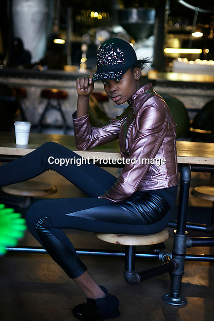 CAPE TOWN, SOUTH AFRICA AUGUST 13: Favour Lucky, a 15-year old Nigerian model, drinks a coffee in a café on August 13 2013 in Cape Town, South Africa. She won Nigeria's next supermodel and has worked at fashion weeks in Johannesburg, Cape Town, New York and others. (Photo by: Per-Anders Pettersson)