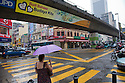 A road junction with an elevated RapidKL railway in a rainy downtown Kuala Lumpur.  Kuala Lumpur, Selangor, Malaysia