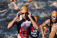 20 JUL 2013 - HAMBURG, GER - Andrew Yorke (CAN) of Canada heads for transition at the end of the swim during the elite men's ITU 2013 World Triathlon Series round in the Altstadt Quarter, Hamburg, Germany (PHOTO COPYRIGHT © 2013 NIGEL FARROW, ALL RIGHTS RESERVED)