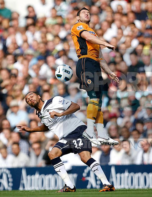 Benoit Assou-Ekotto of Tottenham Hotspur and Matthew Jarvis of Wolverhampton Wanderers leap for the ball