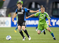 Bobby Convey of Earthquakes dribbles the ball away from Osvaldo Alonso of the Sounders during the game at Buck Shaw Stadium in Santa Clara, California on July 31st, 2010.   Seattle Sounders defeated San Jose Earthquakes, 1-0.