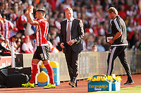 Southampton Manager Ronald Koeman  with Dusan Tadic during the Barclays Premier League match between Southampton v Swansea City played at St Mary's Stadium, Southampton