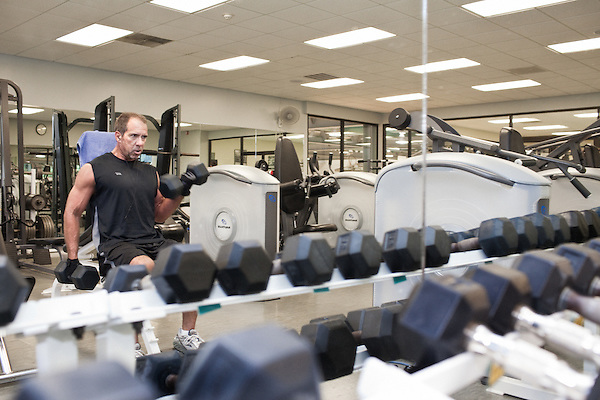 July 29, 2011. Cary, NC.. Michael Anthony, a 23 year veteran of SAS, works out in the on campus gym, which is provided free of cost to employes.. Profile of SAS, a software company that has many amenities for its employees.