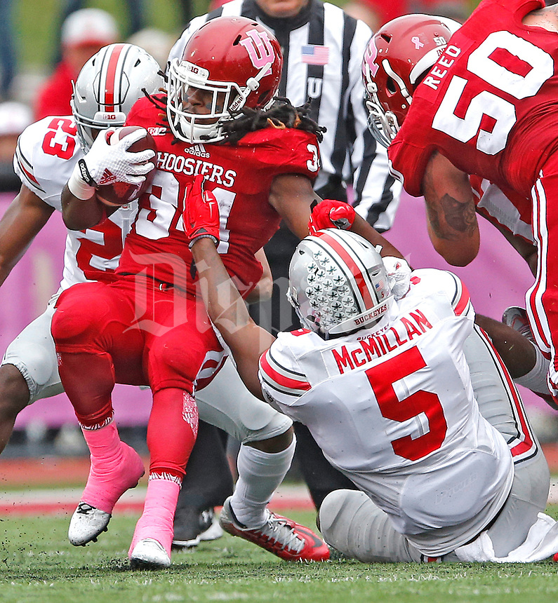 Ohio State Buckeyes linebacker Raekwon McMillan (5) pulls down Indiana Hoosiers running back Devine Redding (34) in first half play pat Memorial Stadium on October 3, 2015. (Chris Russell/Dispatch Photo)