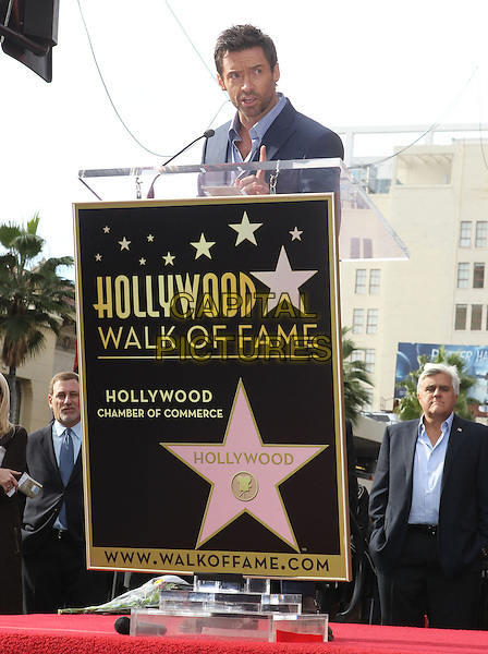 Hugh Jackman.Hugh Jackman is honoured with a Hollywood Star Held on the Hollywood Walk of Fame, Hollywood, California, USA, 13th December 2012..half length navy blue suit shirt podium microphone speaking .CAP/ADM/KB.©Kevan Brooks/AdMedia/Capital Pictures.