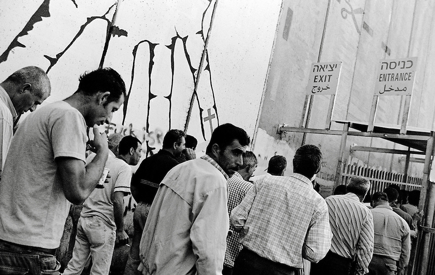 Palestinian men stand in line to enter Jeruslaem at a checkpoint near Bethlehem, The West Bank, October 2009. Photo: Ed Giles.