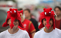 Two young male Wales supporters wearing red dragon hats arrive to the stadium prior to the FIFA World Cup Qualifier Group D match between Wales and Austria at The Cardiff City Stadium, Cardiff, Wales, UK. Saturday 02 September 2017
