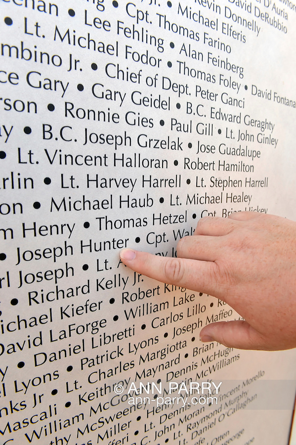 "East Meadow, New York, U.S. 11th September 2013. ROSEMARY HUNTER, of Wantagh, points her finger to name of her brother-in-law, Joseph G Hunter, during her visit to the Global War on Terror ""Wall of Remembrance"" a traveling memorial on display in New York for the first time, at Eisenhower Park on the 12th Anniversary of the terrorist attacks of 9/11. Joseph Hunter was a firefighter, in Squad 288 in Maspeth Queens, who died September 11, 2001. The unique 94 feet long by 6 feet high wall has, on one side, almost 11,000 names of those lost on September 11th 2001, along with heroes and veterans who lost their lives defending freedom of Americans over past 30 years."
