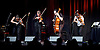 FourPlay String Quartet with special guest Neil Gaiman perform live at the Leicester Square Theatre, London, Great Britain <br /> 5th June 2015 <br /> <br /> LARA GOODRIDGE (VIOLIN &amp; VOCALS)<br /> SHENTON GREGORY AKA SHENZO GREGORIO (VIOLA &amp; VOCALS)<br /> TIM HOLLO (VIOLA &amp; VOCALS)<br /> PETER HOLLO (CELLO &amp; VOCALS)<br /> with Neil Gaiman <br /> <br /> Photograph by Elliott Franks <br /> <br /> Image licensed to Elliott Franks Photography Services