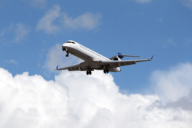 LOS ANGELES, CALIFORNIA, USA - MARCH 8, 2013 - United Express Bombardier CRJ-701 takes off from Los Angeles Airport on March 8, 2013. The plane has a range of 2,656 km with 66 seats.
